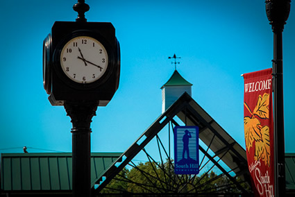 Rotary Club clock, Farmers Market, and street banner in South Hill VA